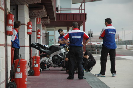 BQR team members looking at the LaGlisse Moto2 bike.